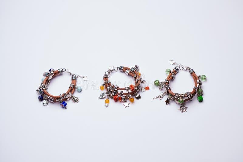 Três Lucky Charm Leather Bracelets colorido imagens de stock royalty free