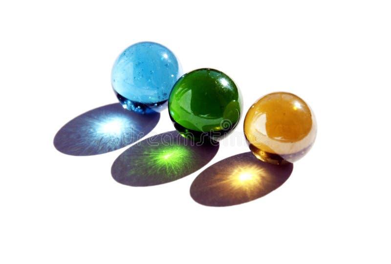Três mármores imagens de stock royalty free