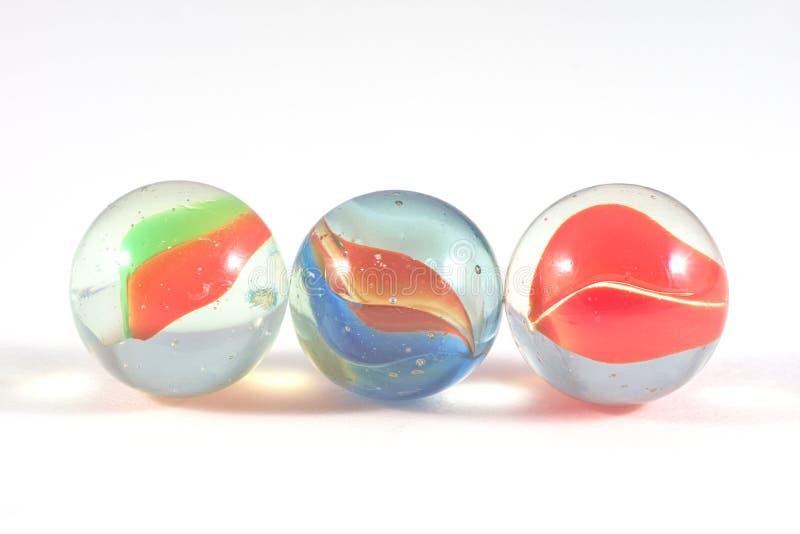 Três mármores de vidro fotografia de stock royalty free