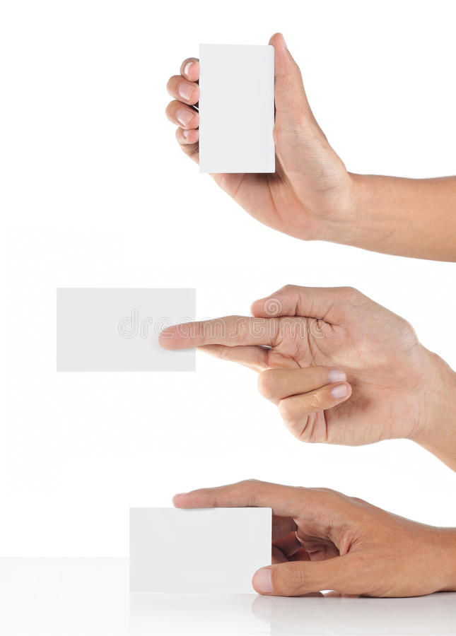 Três mãos que mostram um cartão fotografia de stock