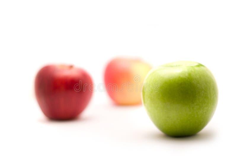 Três maçãs no fundo branco foto de stock