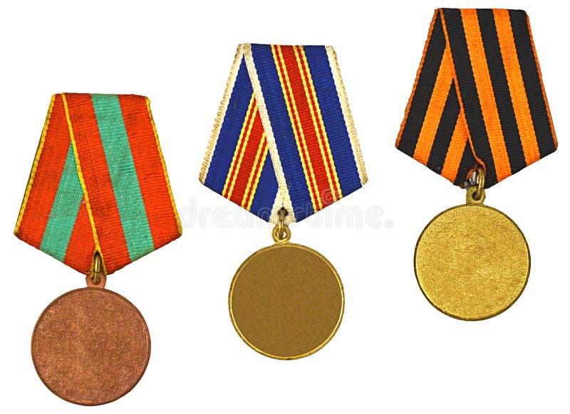 Três medalhas isoladas no branco fotos de stock