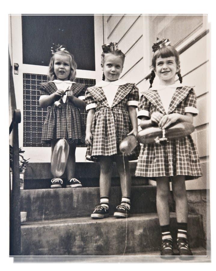 Três meninas/aniversário/retro foto de stock