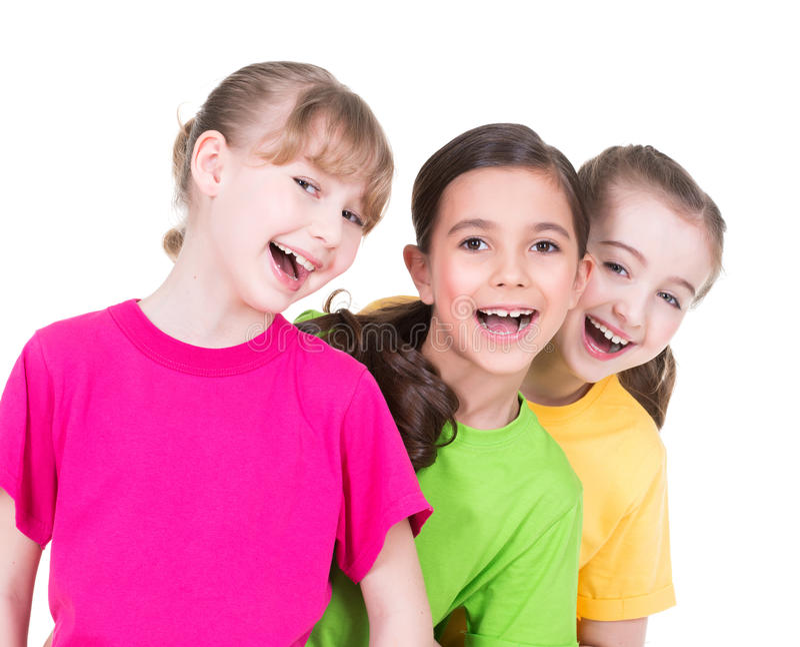 Três meninas de sorriso bonitos pequenas bonitos. fotografia de stock royalty free