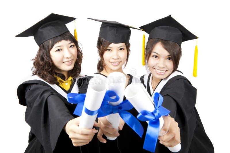 Três meninas do asian da graduação imagens de stock