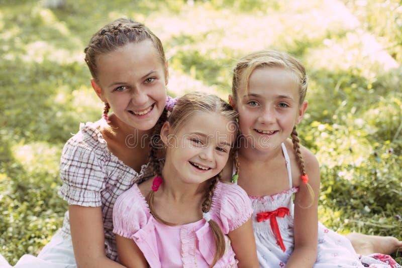Três meninas fora imagem de stock royalty free