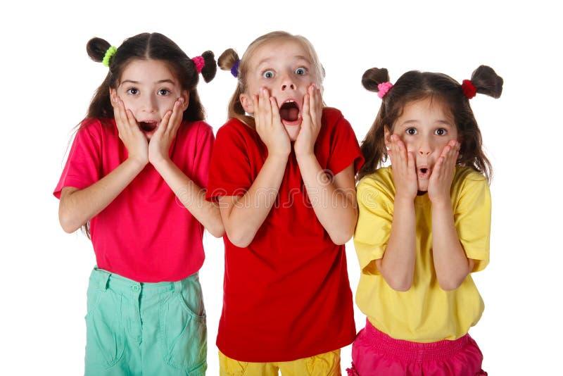 Três meninas surpreendidas fotografia de stock