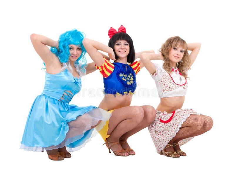 Três meninas vestidas na roupa da boneca imagens de stock royalty free