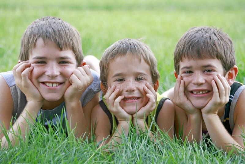 Três meninos fotos de stock royalty free