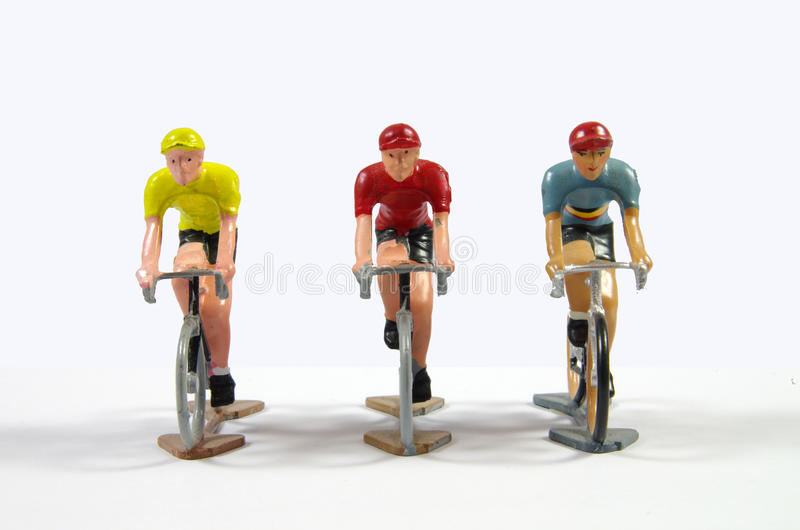 Três metal Cyclists modelo imagem de stock royalty free