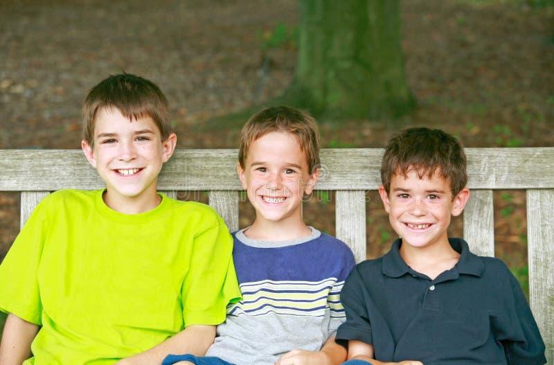 Três miúdos foto de stock