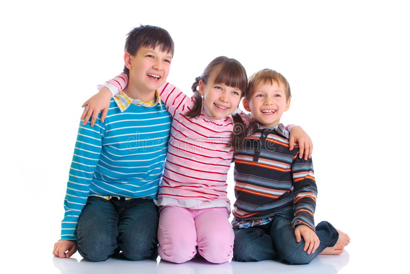 Três miúdos felizes foto de stock royalty free