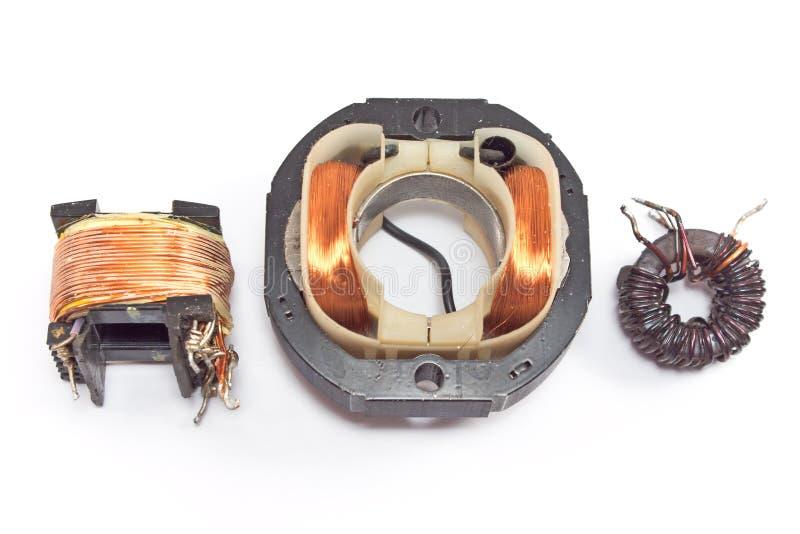 Três motores de cobre bondes da bobina imagem de stock