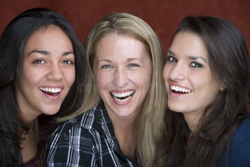 Três mulheres de sorriso imagens de stock