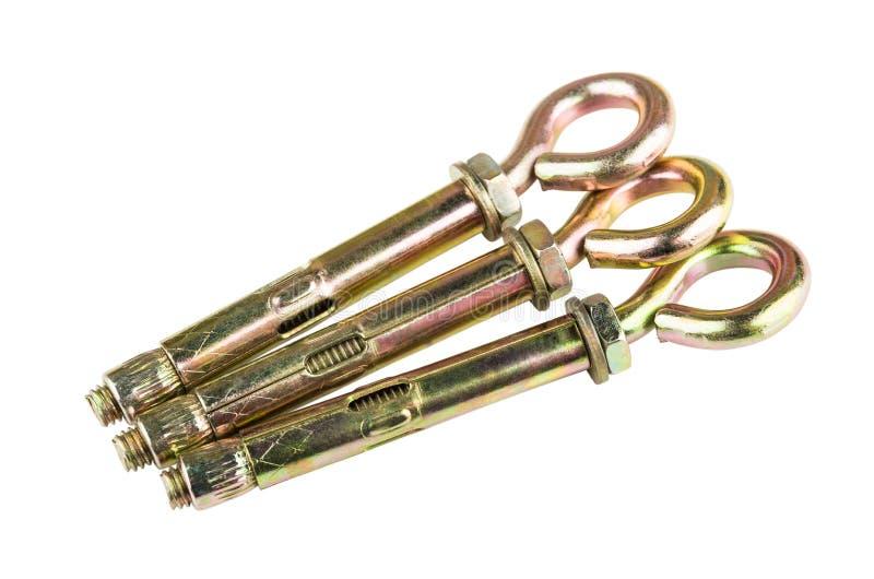Três parafusos de âncora com o anel isolado no branco fotos de stock