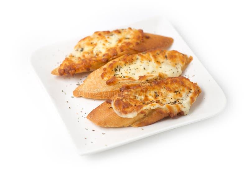 Três partes de pão de alho cobertas com queijo imagens de stock royalty free