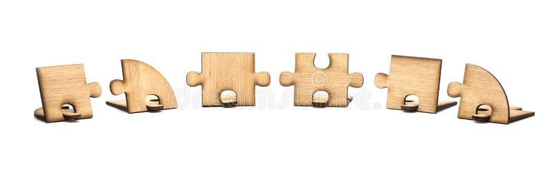 Três partes de serra de vaivém de madeira são conectadas isoladas junto no fundo branco Conceito da conex?o imagem de stock royalty free