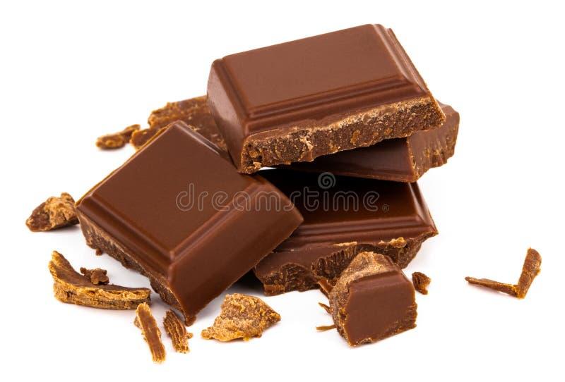 Três partes do chocolate de leite isoladas no fundo branco foto de stock royalty free