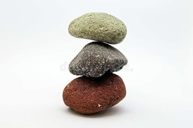 Três pedras equilibradas da cor foto de stock