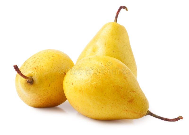 Três peras amarelas isoladas no branco fotos de stock