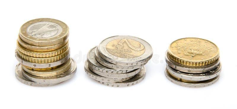 Três pilhas de moedas foto de stock