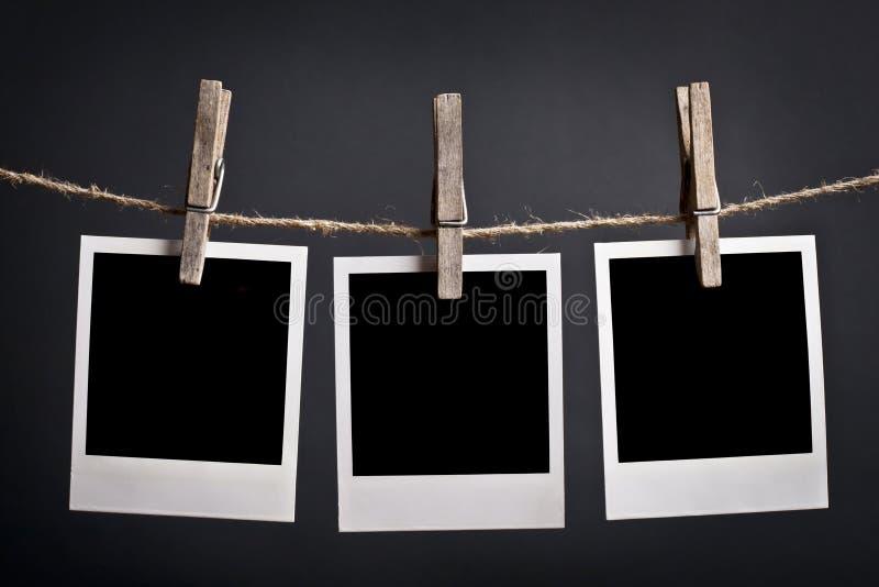 Três Polaroids fotografia de stock