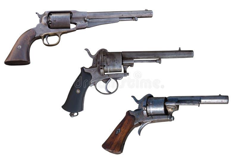 Três revólveres velhos Arma antiga fotos de stock royalty free