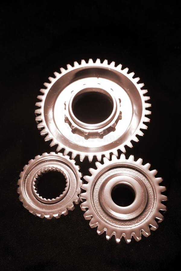 Três rodas denteadas imagem de stock