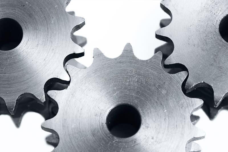 Download Três Rodas Denteadas No Fundo Branco Imagem de Stock - Imagem de metal, três: 12806453