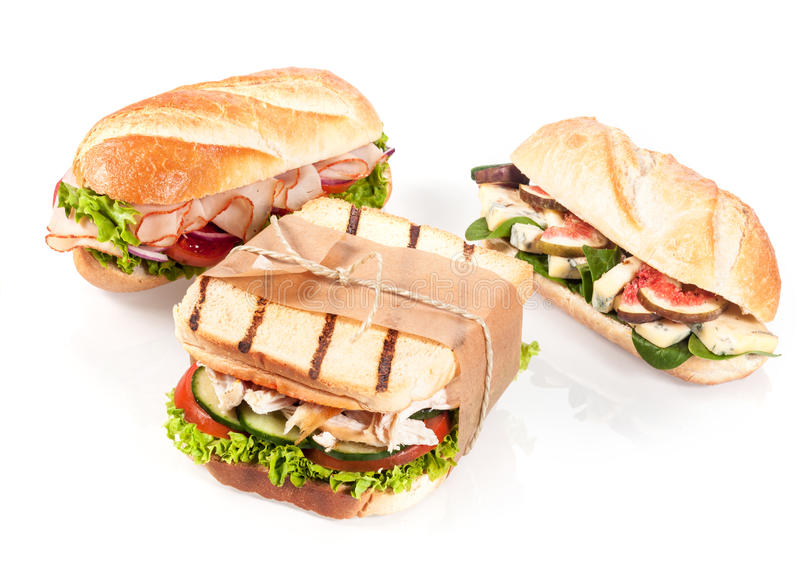 Três sanduíches gourmet imagens de stock royalty free