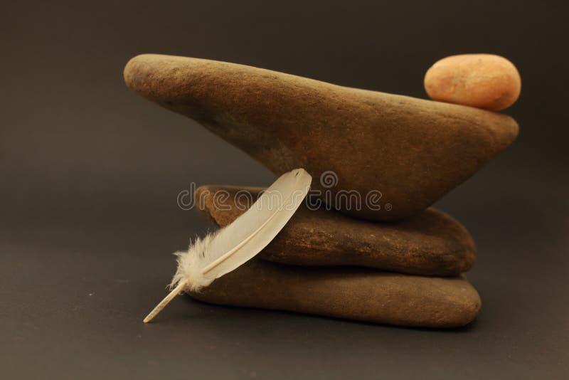Três seixos sobrepostos em se foto de stock