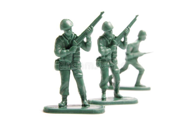 Três soldados de brinquedo fotos de stock royalty free