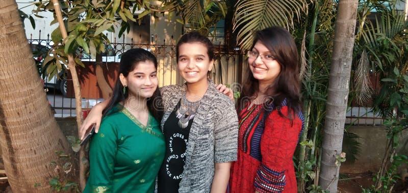 Três sorrisos bonitos fotografia de stock