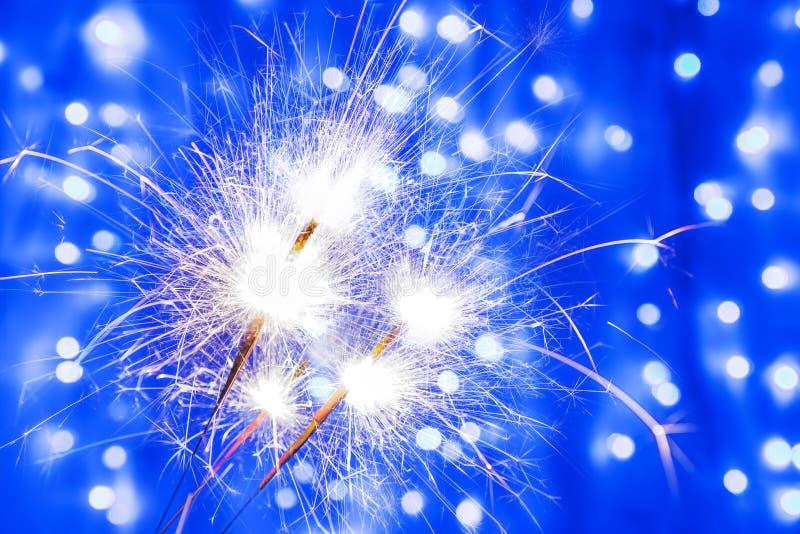 Três sparkles do fogo de Bengal no ano novo e no Natal foto de stock