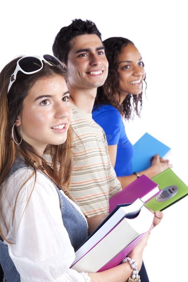 Três studens adolescentes fotografia de stock royalty free