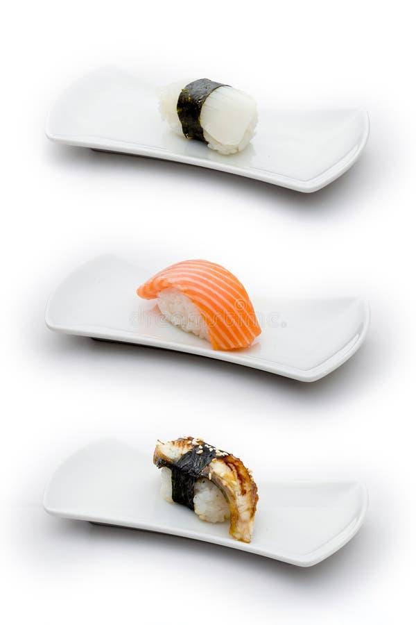 Três tipos de sushi: calamaro, salmões e enguia imagens de stock