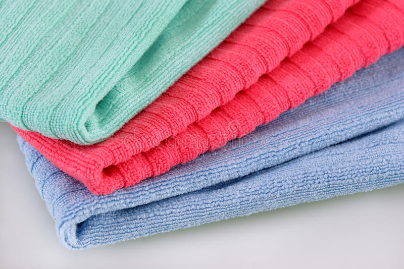 Três toalhas de terry dobradas fotografia de stock