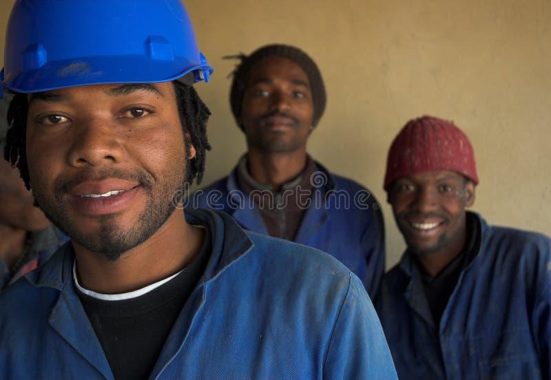 Três trabalhadores da construção fotos de stock