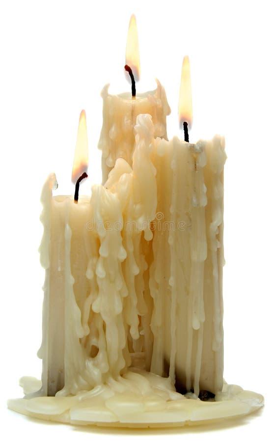 Três velas velhas bonitas foto de stock