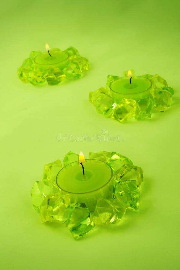 Três velas verdes imagem de stock royalty free