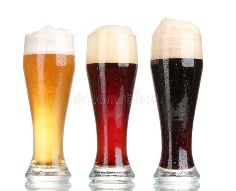 Três vidros com cervejas diferentes imagens de stock royalty free