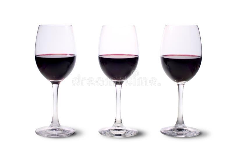Três vidros de vinho vermelho fotografia de stock royalty free