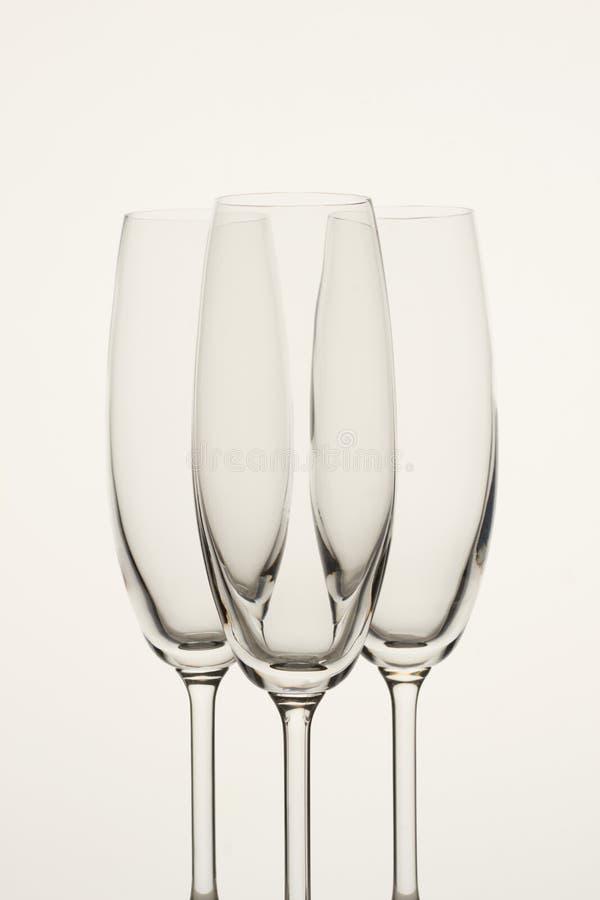 Três vidros vazios do champanhe isolados no branco foto de stock royalty free