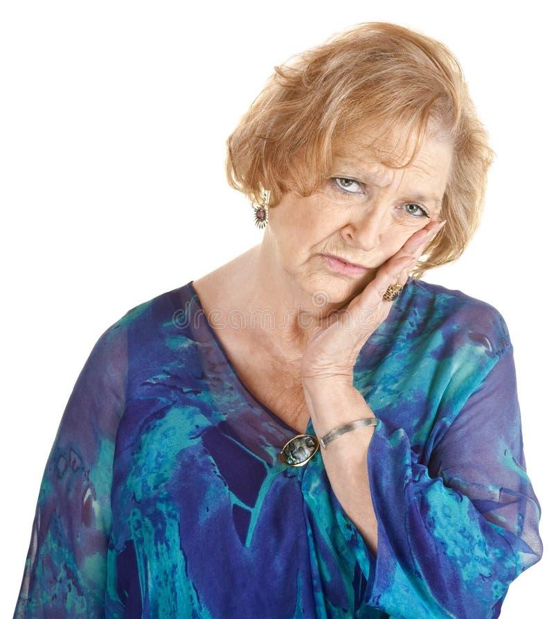 Trött äldre kvinna arkivfoto