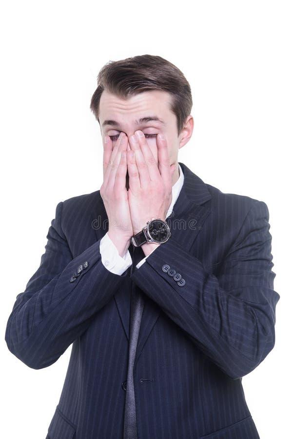Trött affärsman som gnider hans ögon arkivbild
