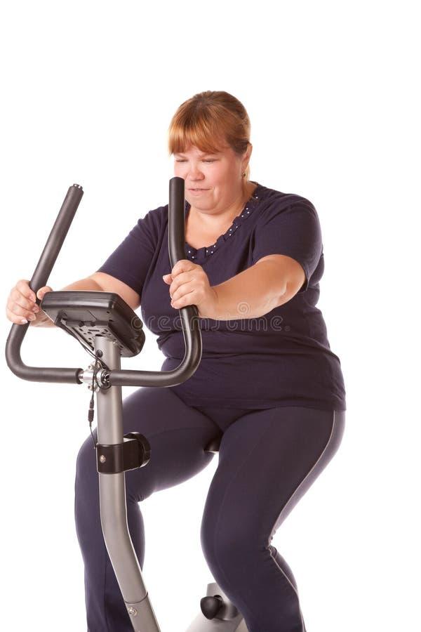 Trött fet kvinna arkivbild