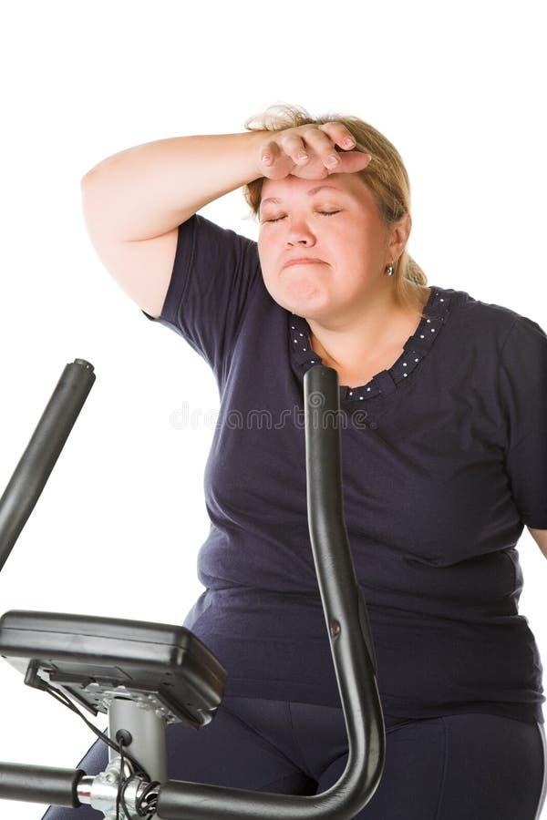 trött kvinna för fett arkivbilder