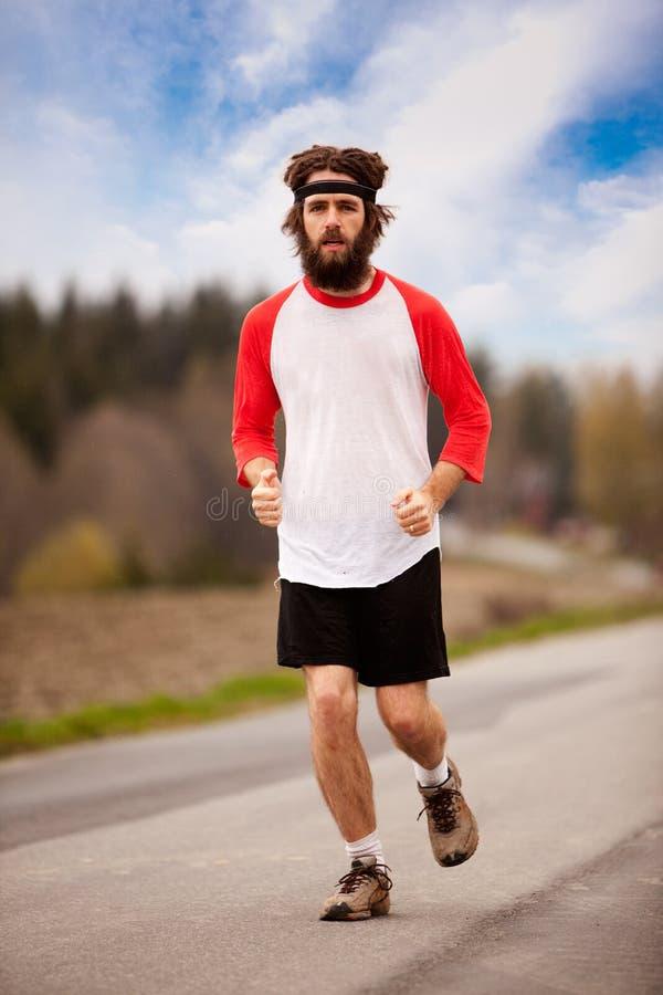 tröttad jogger royaltyfri foto