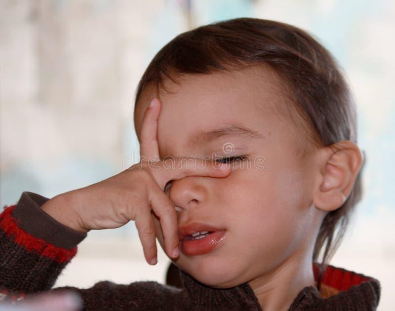 tröttad pojke royaltyfria foton