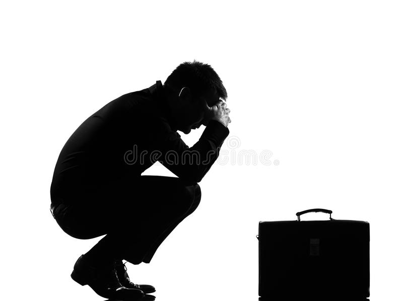 tröttad silhouette för förtvivlantrötthetsman fotografering för bildbyråer